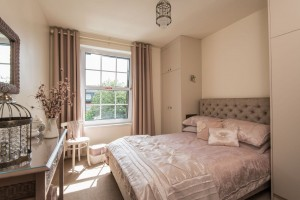 A photo of the master bedroom showing double bed and outlook over Windsor Court
